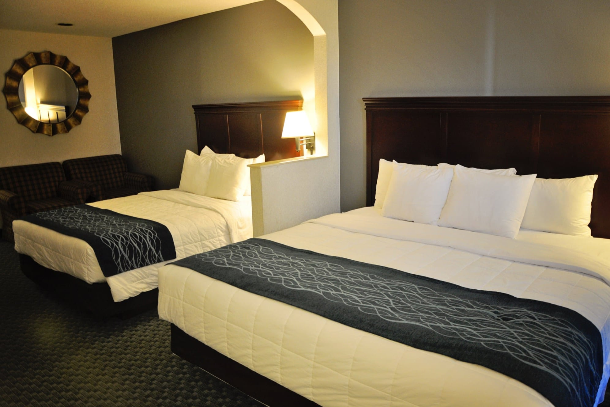 For a little added floor space we offer a room with 1 queen bed and 1 king bed. It comes with a refrigerator