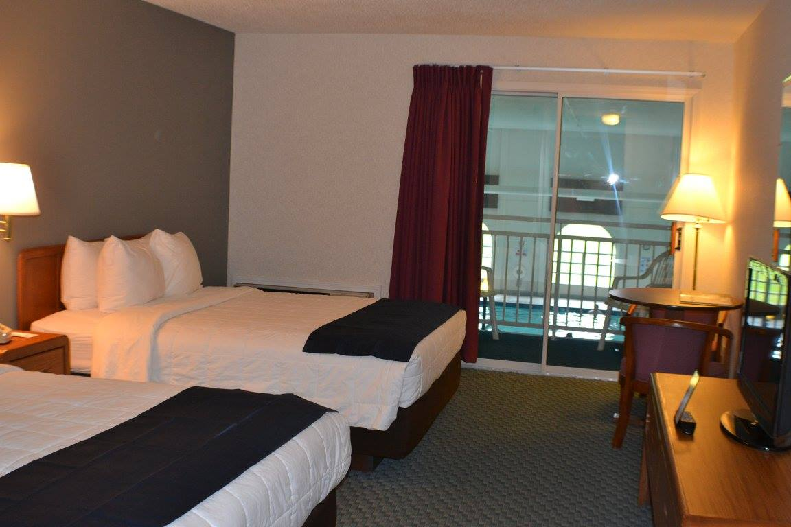 We also have rooms with 2 queen beds with a balcony overlooking our indoor pool. These rooms have a refrigerator
