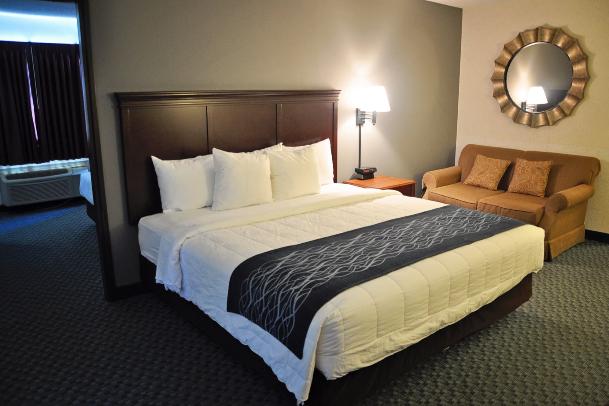 Our largest room is a 2 bedroom suite. It has a king bed and love seat in the main room with a flat screen TV, refrigerator