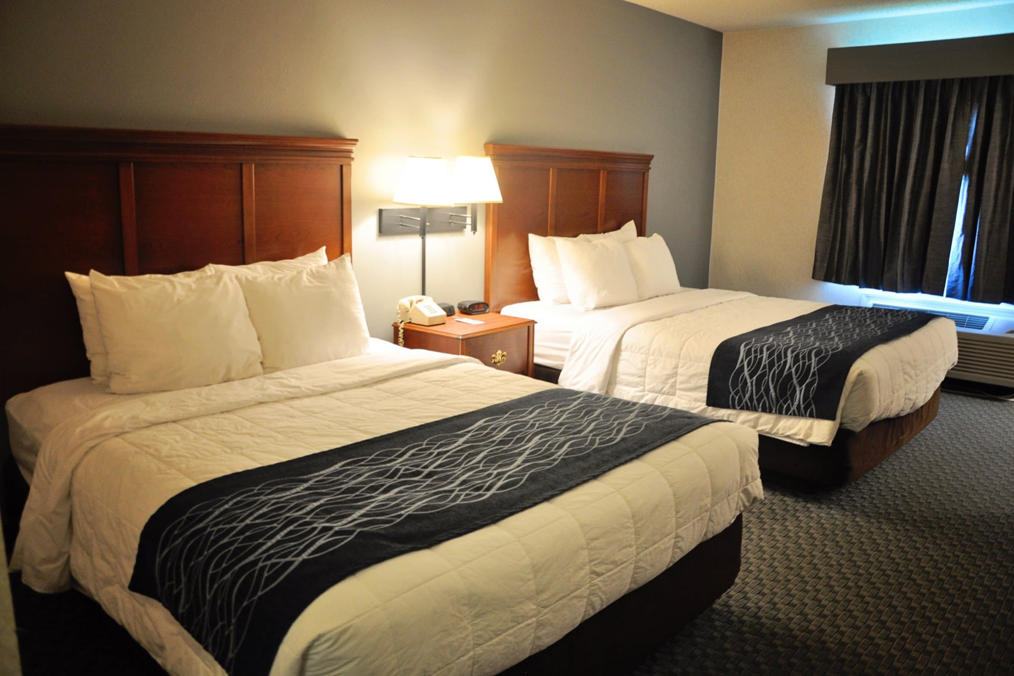 Our Standard room features 2 queen size beds with 4 comfy pillows on each bed, 2 firm and 2 soft so you can pick your favorite!